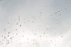 Tropfen auf Glas Stockfotografie