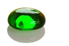 Tropfen des grünen Glases Stockfotografie