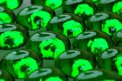 Tropfen des grünen Glases Lizenzfreie Stockfotos