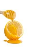 Tropfen des Honigs und der Zitrone Lizenzfreie Stockbilder