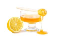 Tropfen des Honigs und der Zitrone Stockfoto