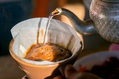 Tropfenfänger-Kaffee Stockfotos