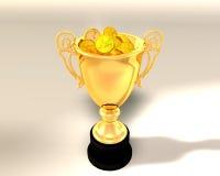 Trophäecup und -münzen Stockfoto