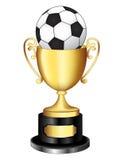 Trophée d'or avec du ballon de football Images stock