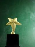 Trophée de forme d'étoile Photos stock