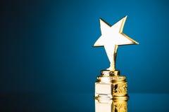 Trophée d'étoile d'or Image stock