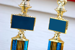 Trophies. Trophy(ies) with blank plates, allowing a custom message to be inserted Stock Image
