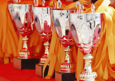 Trophies. Row of trophies and ribbons at a sport event Stock Photos