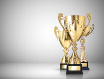Trophies. Golden trophies on gray background royalty free illustration