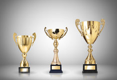Trophies. Golden trophies on gray background stock illustration