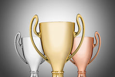 Trophies on gray Royalty Free Stock Photos