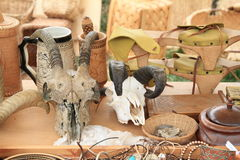 Trophies. Head bones with horns on table with clogs, jewels and tankards Stock Images