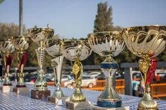 Trophies for the race. A set of cups or trophies ready to be delivered to the winners of the race Stock Photos