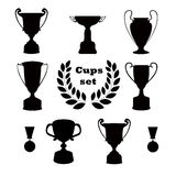 Trophies, set of silhouettes. Set of sports trophies and awards Stock Images