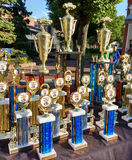 Trophies to be Awarded at a Classic Car Show. Rutherford, New Jersey, USA: A table full of various trophies to be given out at the 2nd Annual Rutherford EMS Car royalty free stock images