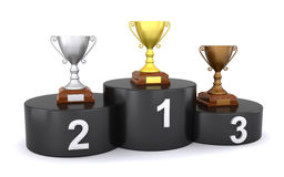 Trophies on the winner's podium. Golden, silver and bronze trophy on a black winner's podium (3d render&#x29 Royalty Free Stock Photos