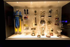 Trophies won by Fernando Alonso in 2005, along with the equipment of that same year. royalty free stock image