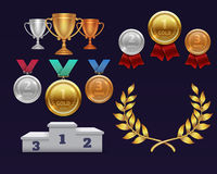 Trophy awards gold cup and golden laurel wreath, medals and sports podium Stock Photo