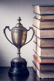 Trophy and book Stock Image