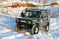Trophy Challenge. UFA, RUSSIA - DECEMBER 18: Off-road vehicle UAZ #35 of team ROTAS during annual trophy raid Natural selection on December 18, 2010 in Ufa Royalty Free Stock Photography