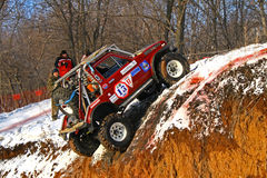 Trophy Challenge. UFA, RUSSIA - DECEMBER 18: Off-road vehicle NIVA #13 of team BASHOFFROAD during annual trophy raid Natural selection on December 18, 2010 in Stock Image