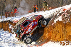 Trophy Challenge. UFA, RUSSIA - DECEMBER 18: Off-road vehicle Lada Niva (No. 13) of team BASHOFFROAD during annual trophy raid Natural selection on December 18 Royalty Free Stock Images