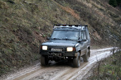 Trophy challenge. Off-road vehicle Land Rover Discovery takes part at the annual trophy challenge Samhain on October 31, 2009 in Minyar, Chelyabinsk region Royalty Free Stock Images