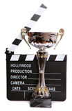 Trophy and clapper board Stock Photos
