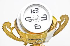 A trophy with a clock. In side representing time management royalty free stock images