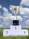 Trophy cup. Silver trophy cup on first place podium royalty free stock photo