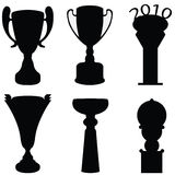 Trophy cup. Silhouette black set Stock Photos