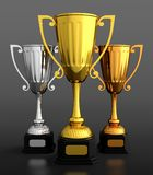 Trophy cup. 3D render of gold silver and bronze trophy cups on black background Stock Image