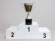 Trophy cup. Silver trophy cup on white podium royalty free stock images