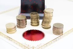 Trophy Cup and coins and blank certificate. On white background royalty free stock images