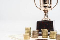 Trophy Cup and coins and blank certificate. On white background royalty free stock image