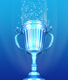 Trophy Cup and confetti over blue background Royalty Free Stock Image