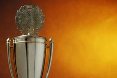 Trophy cup on orange background. Trophy cup and orange background stock photography