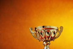 Trophy cup on orange background Stock Images
