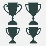 Trophy cup silhouettes in four variants. Isolated vector image vector illustration