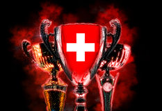 Trophy cup textured with flag of Switzerland. Digital illustration.  Royalty Free Stock Photos