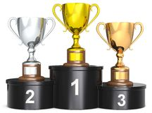 Trophy Cups. Black podium with 3 Trophies. Dark wood base. Gold, silver, bronze Stock Photo