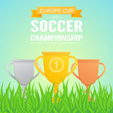 Trophy cups on field grass. Royalty Free Stock Images