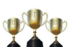 Trophy cups for first, second and third places Royalty Free Stock Images