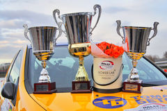Trophy cups and flowers. Moscow, Russia - Apr 18, 2015: Trophy cups and flowers stand on the hood of the Subaru Impreza after the Rally Masters Show 2015 at the stock images