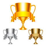 Trophy Cups with Ribbons. Golden, silver and bronze trophy cups with ribbons Stock Photos