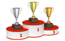 Trophy cups on round winners podium Royalty Free Stock Photo