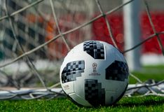 Trophy of the FIFA World Cup. April 9, 2018 Moscow, official ball of FIFA World Cup 2018 Adidas Telstar 18 on the green grass of the football field Royalty Free Stock Image