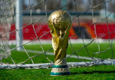 Trophy of the FIFA World Cup. April 9, 2018 Moscow, Russia Trophy of the FIFA World Cup on the green grass of the football field Stock Photo