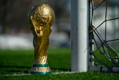 Trophy of the FIFA World Cup. April 9, 2018 Moscow, Russia Trophy of the FIFA World Cup on the green grass of the football field Stock Image