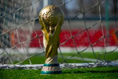 Trophy of the FIFA World Cup. April 9, 2018 Moscow, Russia Trophy of the FIFA World Cup on the green grass of the football field Royalty Free Stock Photography